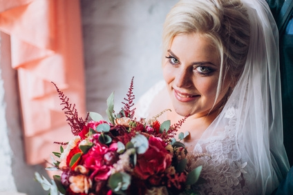 Beautiful bride in plus size wedding dress