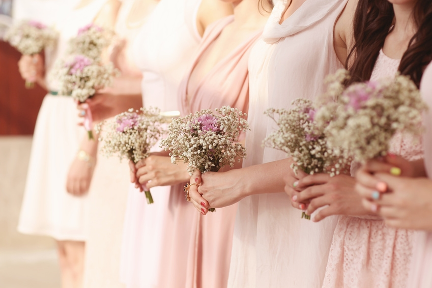 Bridesmaid dresses different styles with matching bouquets and colour fabric - tips for bridesmaid dresses